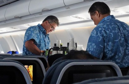 Airbus-A330-200-Hawaiian-Airlines-Economy-Class-Cabin-FA-in-a-Hawaiian-shirt-uniform-served-beverages
