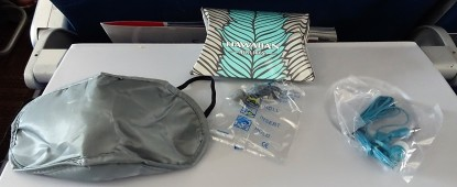 Airbus-A330-200-Hawaiian-Airlines-Economy-Class-Cabin-small-amenity-pouch-containing-a-sleep-mask-earplugs-and-earphones