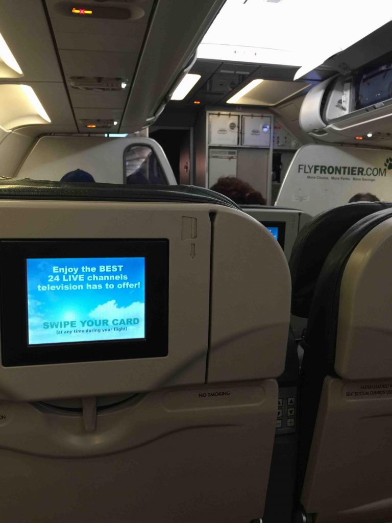 Frontier Airlines Airbus A319 100 cabin interior inflight entertainment system DirectTV on seatback