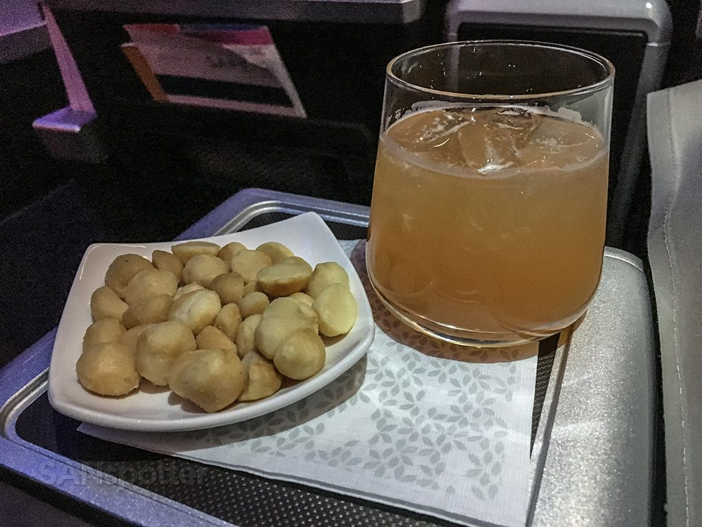 Hawaiian Airlines Aircraft Fleet Airbus A321neo First Class Cabin Inflight Snacks and Drinks Service macadamia nut with guava juice