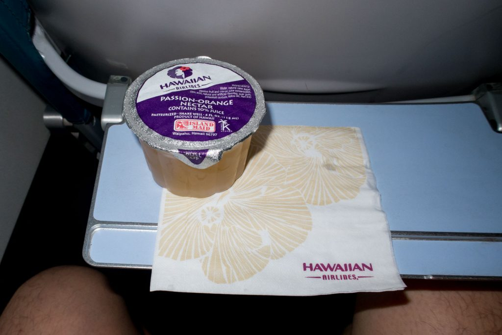 Hawaiian Airlines B717 200 Economy Class Cabin inflight drink services Passion orange nectar