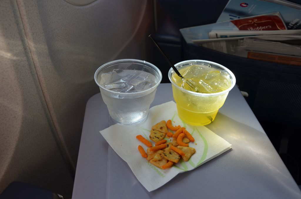 Hawaiian Airlines Boeing 717 200 first class cabin drink orders are taken on ground Mai tai water and some snacks