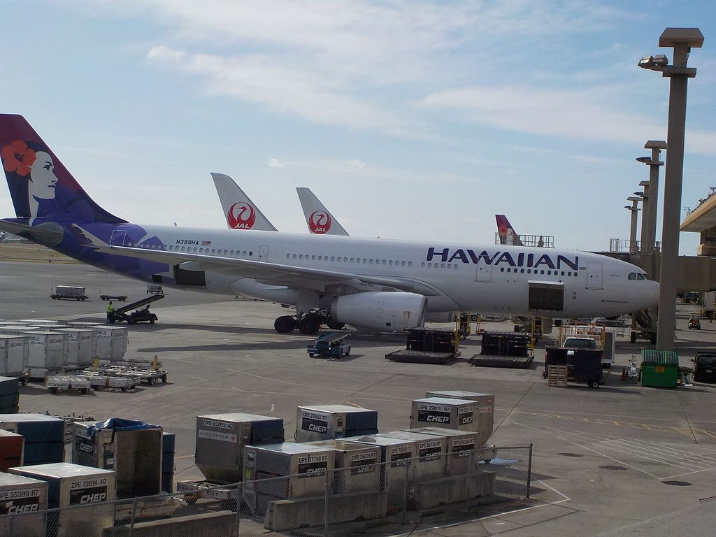 Hawaiian Airlines Fleet Airbus A330 243 N399HA Kūmau parking on boarding gate at at Honolulu International Airport