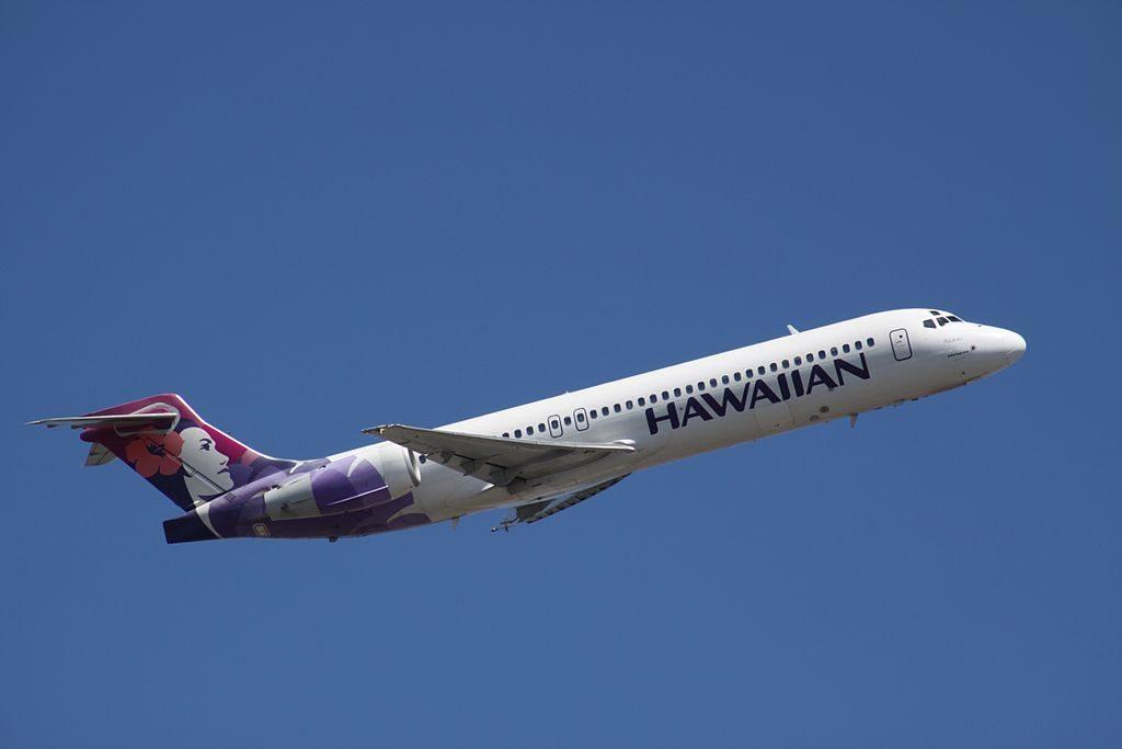 Hawaiian Airlines Narrow Body Aircraft Boeing 717 200 N486HA Akikiki climbing up after takeoff at HNL Honolulu International Airport