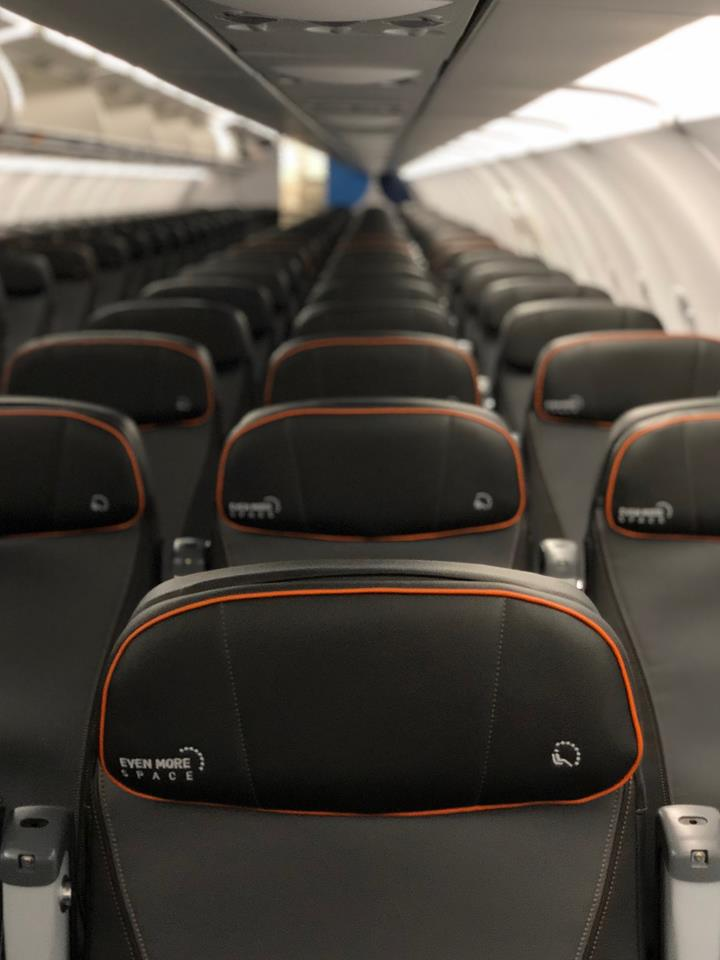 JetBlue Airways Airbus A320 200 Restyled Interior Cabin Modern styled seat designs adjustable headrests Orange lining demarcates Even More Space seats