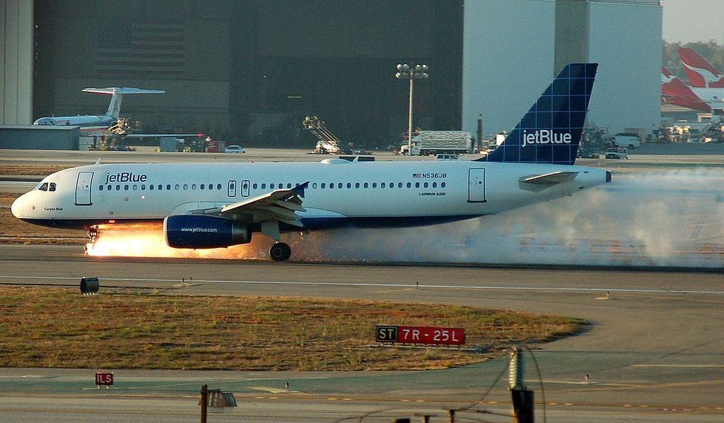 JetBlue Airways Airbus A320 232 N536JB Canyon Blue emergency landing at Los Angeles International AirportHangars in California