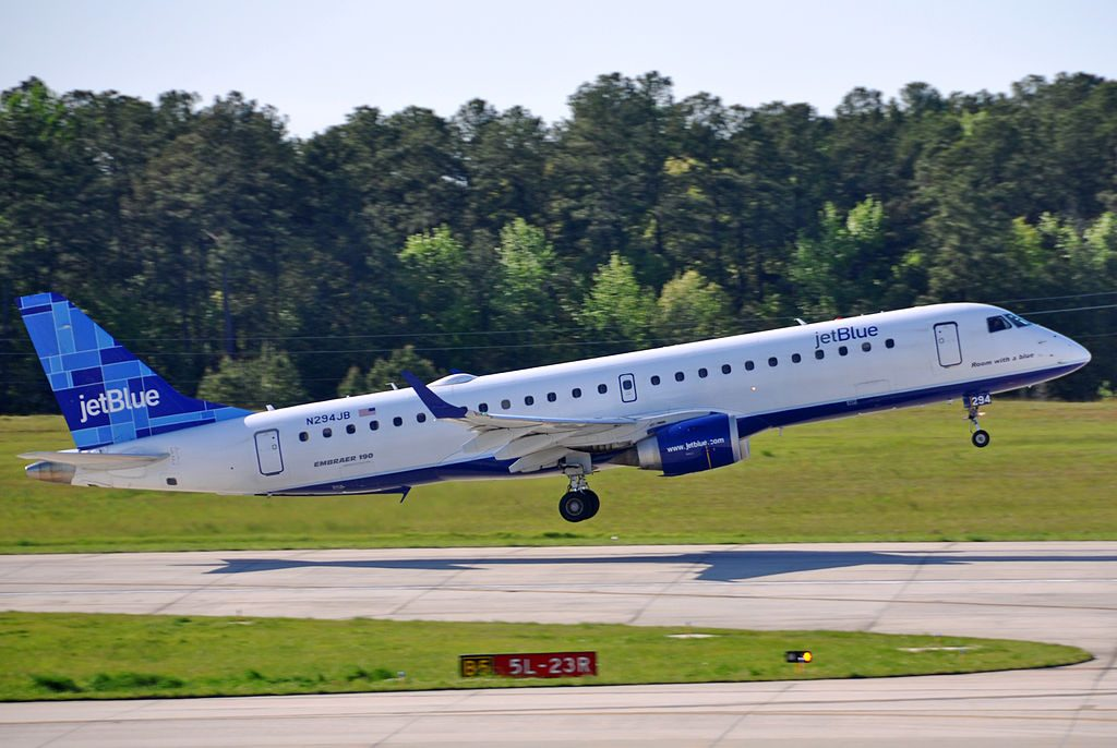 JetBlue Airways N294JB Room with a blue Embraer ERJ 190 100IGW 190AR at Raleigh Durham International Airport