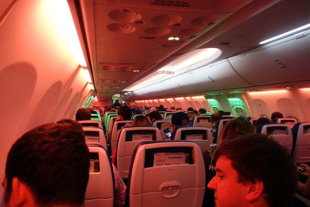 Southwest Airlines Boeing 737 Max 8 Economy Cabin mood lighting redpink color with green around the emergency exits