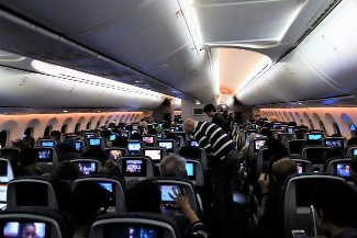United Airlines Aircraft Fleet Boeing 787 9 Dreamliner Economy Class Cabin with mood lighting getting ready for breakfast