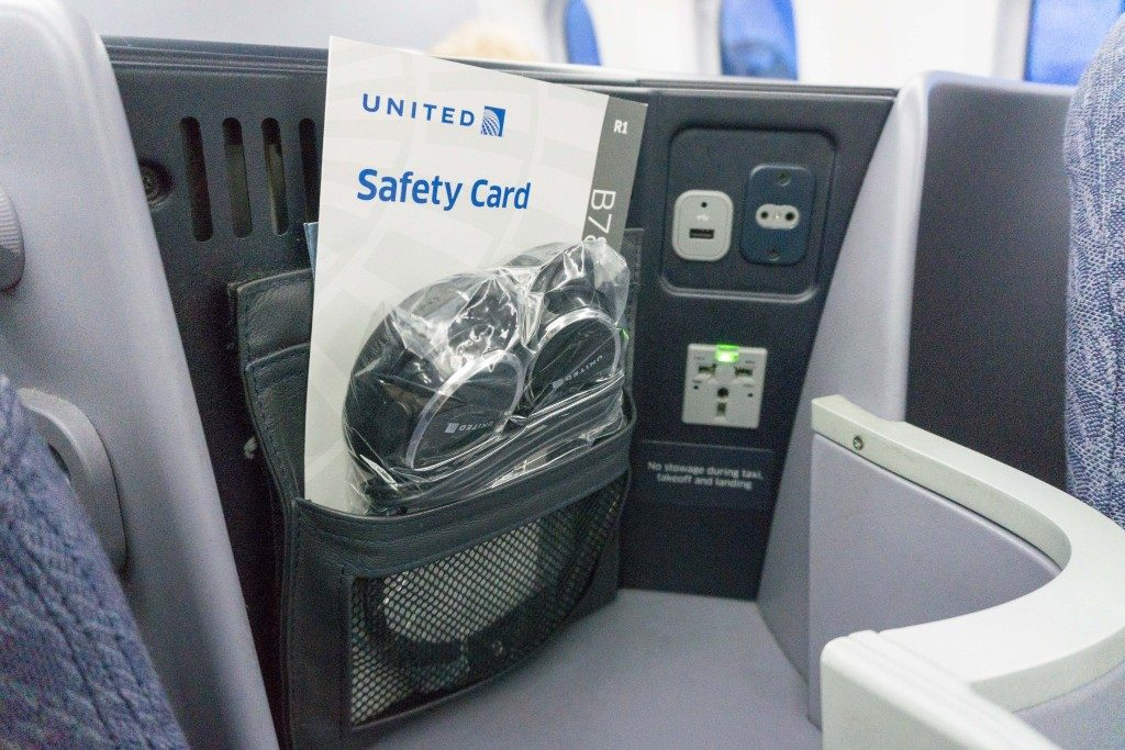 United Airlines Aircraft Fleet Boeing 787 9 Dreamliner Polaris Business Class Cabin small storage with international charging outlet USB port and headphone jack