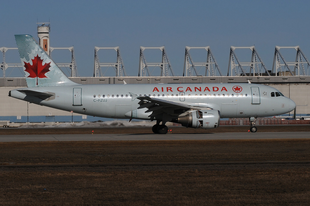 Air Canada Airbus A319 114 C FZUJ at Montréal–Pierre Elliott Trudeau International Airport