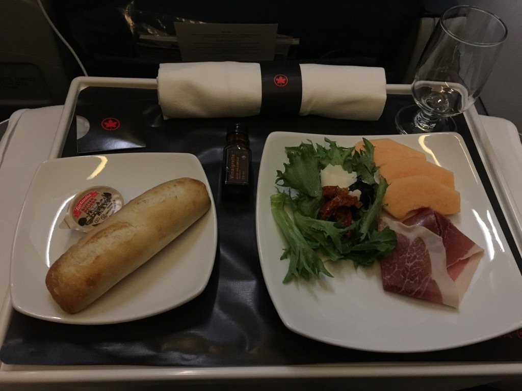 Air Canada Airbus A321 200 Business Class cabin inflight amenities dinner service begins with the appetizer salad on a tray