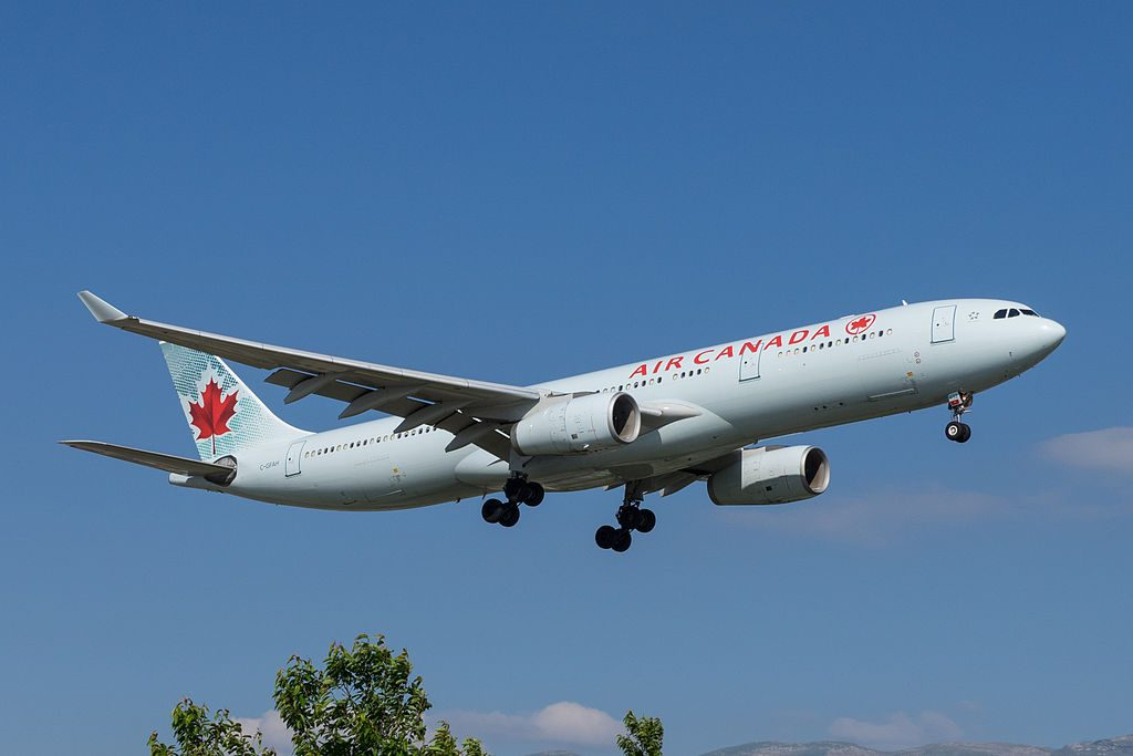 Air Canada Airbus A330 300 C GFAH on final approach before landing at Geneva International Airport