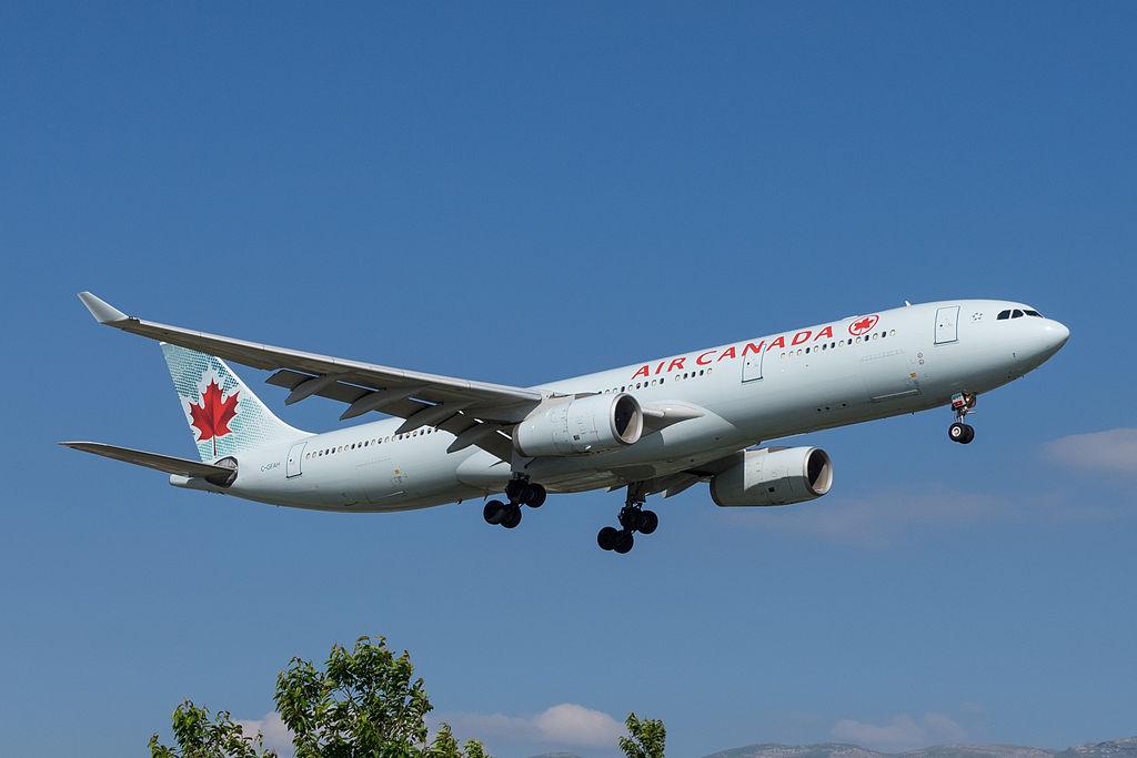 Air Canada Airbus A330 300 C GFAH on final approach before landing at Geneva International Airport