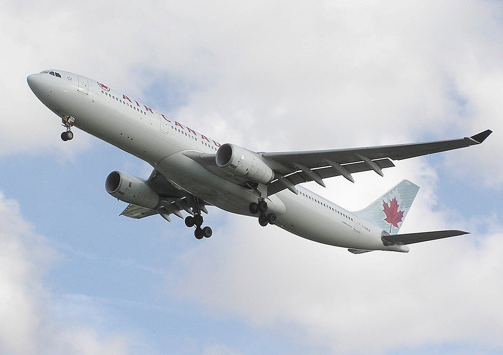 Air Canada Airbus A330 300 C GHKW lands at London Heathrow Airport England