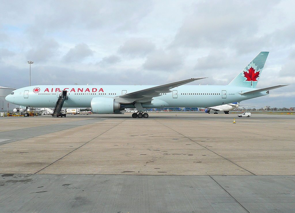 Air Canada Boeing 777 300ER C FIVR on std 595 next to the fuel farm at London Heathrow Airport