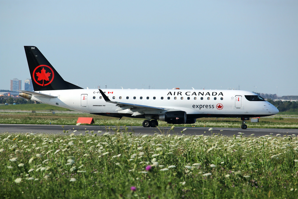 Air Canada Express C FRQM Operated by Sky Regional Airlines Embraer E175 Taxing to runway 23 for departure to Huston Bush IAH CYYZ