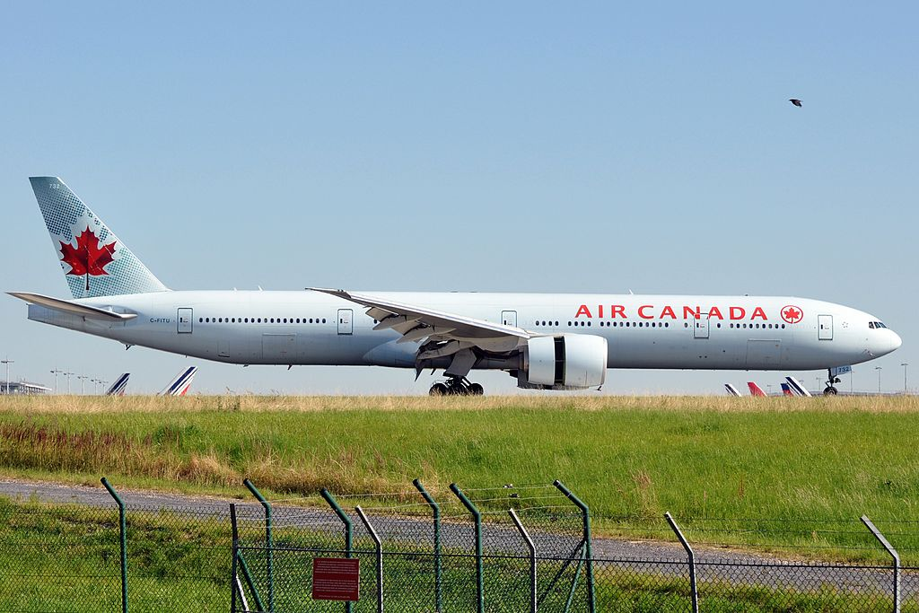 Air Canada Fleet C FITU Boeing 777 300ER landing at Paris Charles de Gaulle Airport