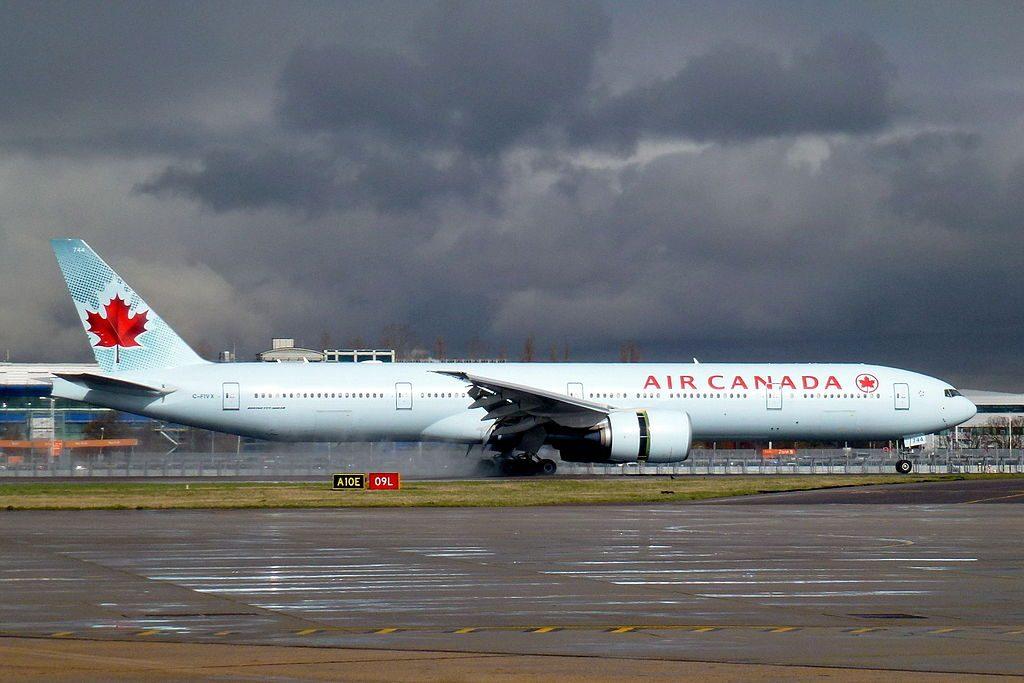 Air Canada Fleet C FIVX Boeing 777 300ER landing rwy 09L at LHR