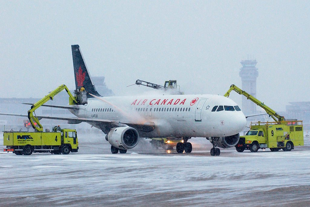 Air Canada Fleet C FTJO Airbus A320 200 being de iced at Montréal Pierre Elliott Trudeau International Airport