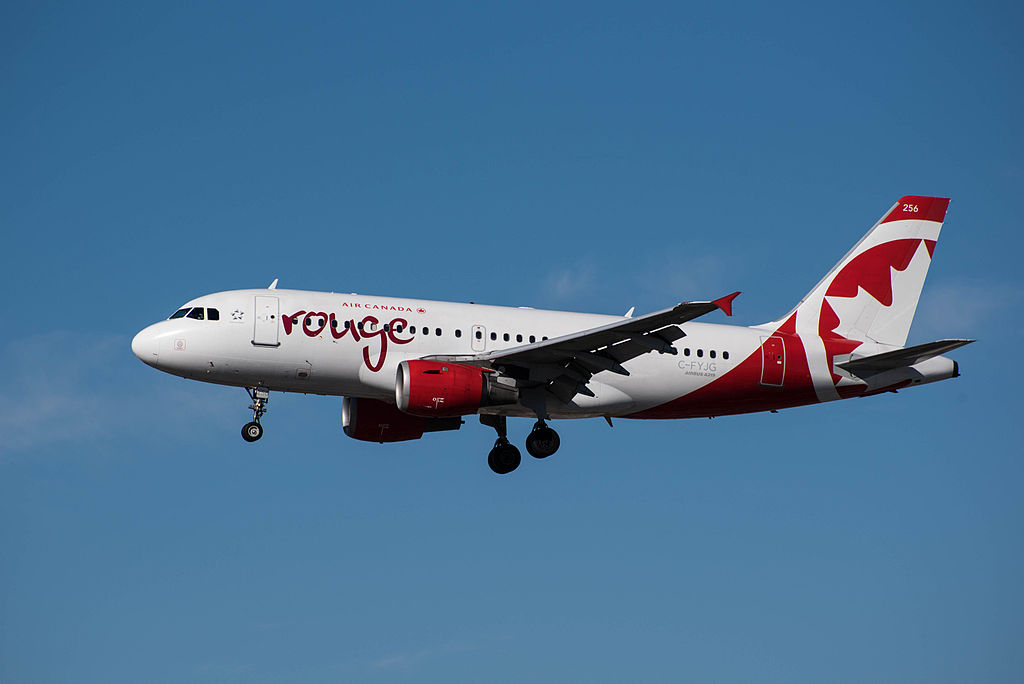 Air Canada Rouge Airbus A319 100 C FYJG on final approach at LAX Airport