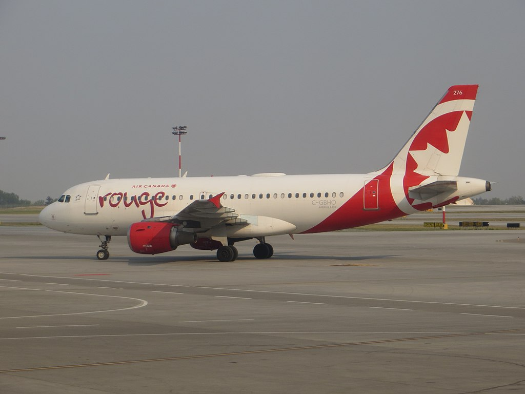 Air Canada Rouge Airbus A319 100 registration C GBHO taxiing at Calgary airport Alberta