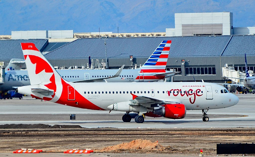 Air Canada Rouge Airbus A319 100 registration C GBHO taxiing at Las Vegas McCarran International Airport LAS KLAS