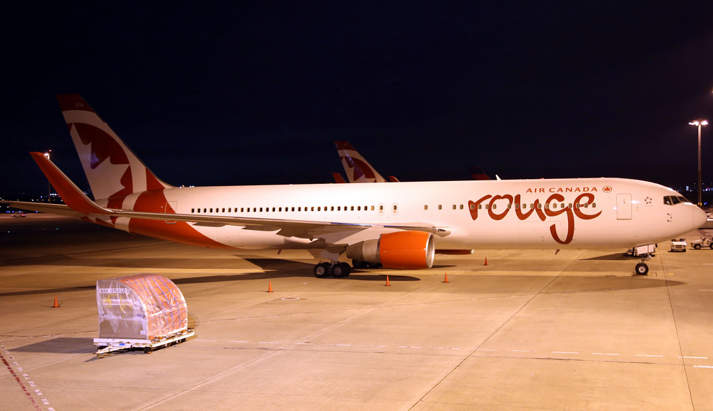 Air Canada Rouge B767 300ER C FMLV parked on the freight apron at OsakaKansai Airport KIXRJBB in Japan
