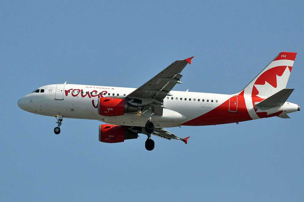 Air Canada Rouge C FYIY Airbus A319 114 cnserial number 634 on final approach at Vancouver International Airport YVR