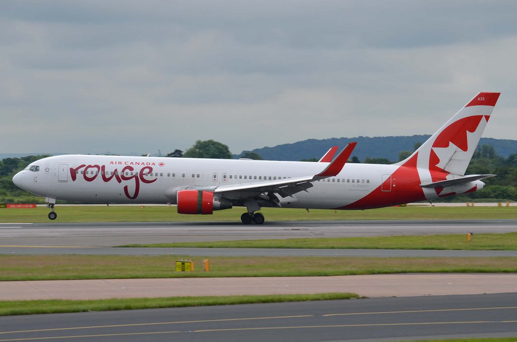 Air Canada Rouge Fleet C FMWY Boeing 767 300ER landing at Manchester Airport
