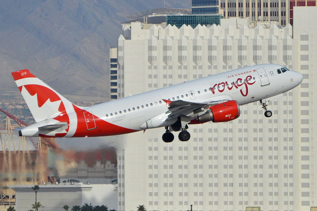 Airbus A319 113 'C GBHZ 279' Air Canada Rouge departing on flight ROU1899 to Vancouver at McCarran International Airport Las Vegas