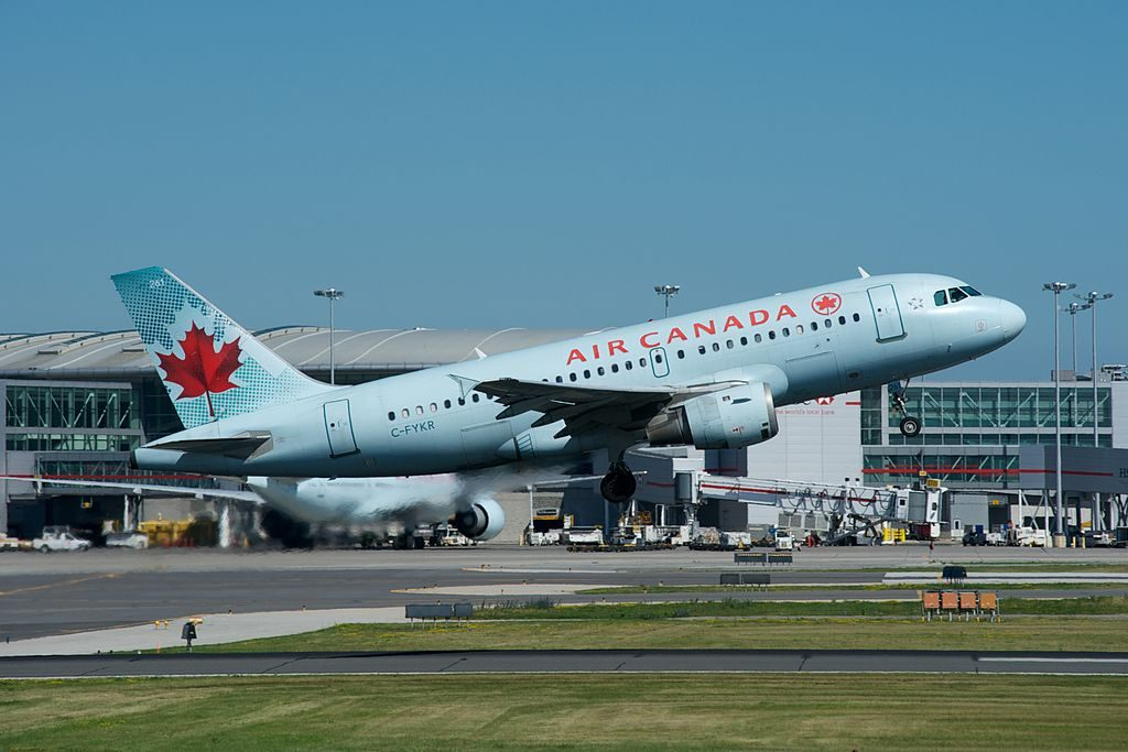 Airbus A319 114 cnserial number 693 Air Canada Fleet C FYKR departing on runway 6L at Toronto Pearson International Airport