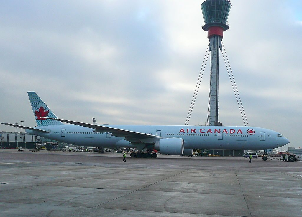 Boeing 777 300ER of Air Canada C FIUL pushing back off std 335 in front of the new control tower at LHR