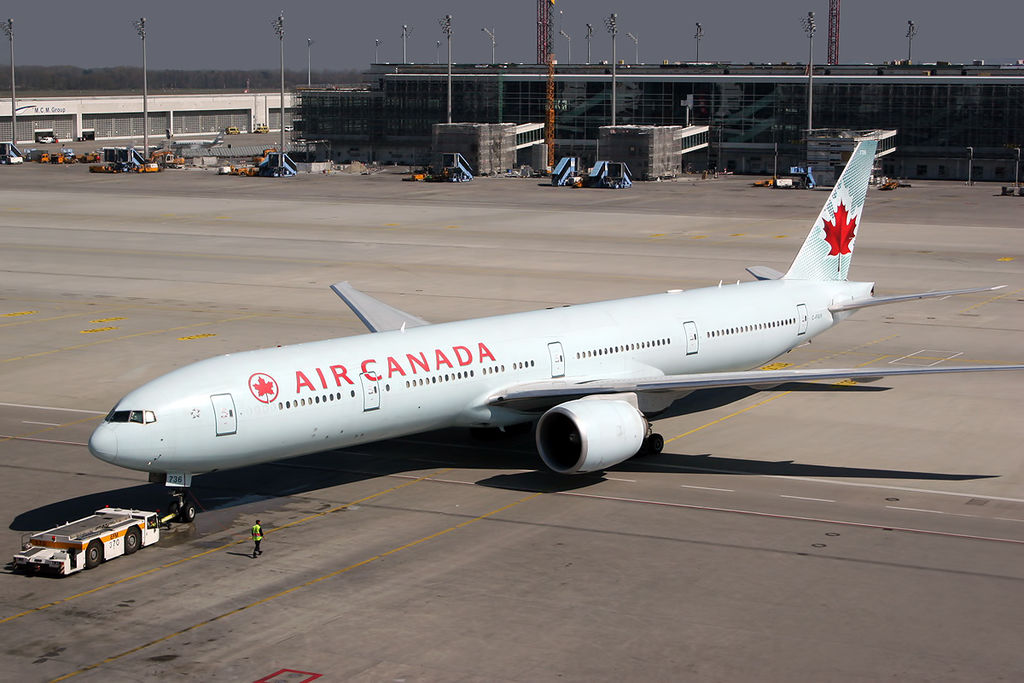 Boeing 777 300ER of Air Canada C FIUV Pushback tractors in Munich Airport