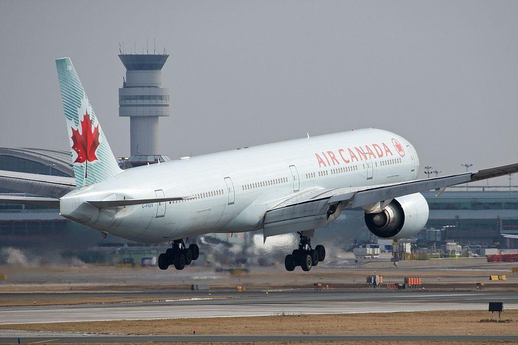 Boeing 777 300ER of Air Canada C FIUV landing at Toronto Pearson International Airport