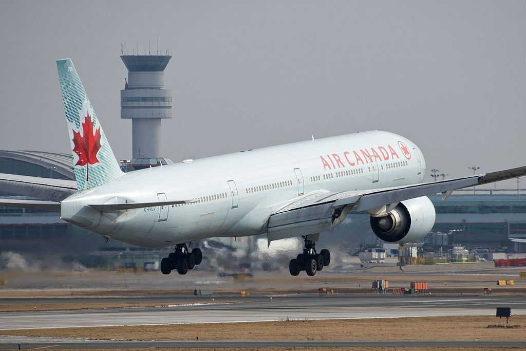 Boeing 777 300ER of Air Canada C FIUV landing at Toronto Pearson International Airport