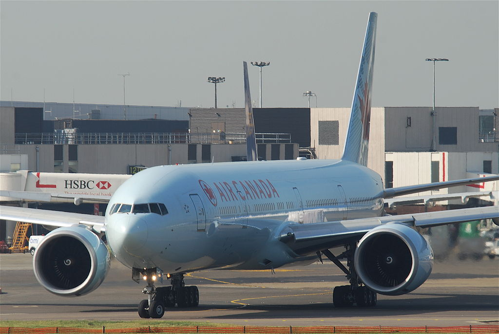 Boeing 777 300ER of Air Canada C FIUV taxiing at London Heathrow Airport