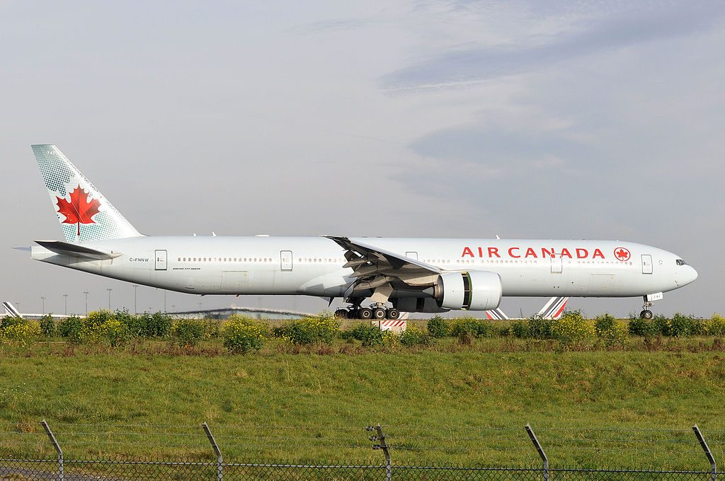 Boeing 777 300ER of Air Canada Fleet C FNNW landing at Paris Charles de Gaulle Airport