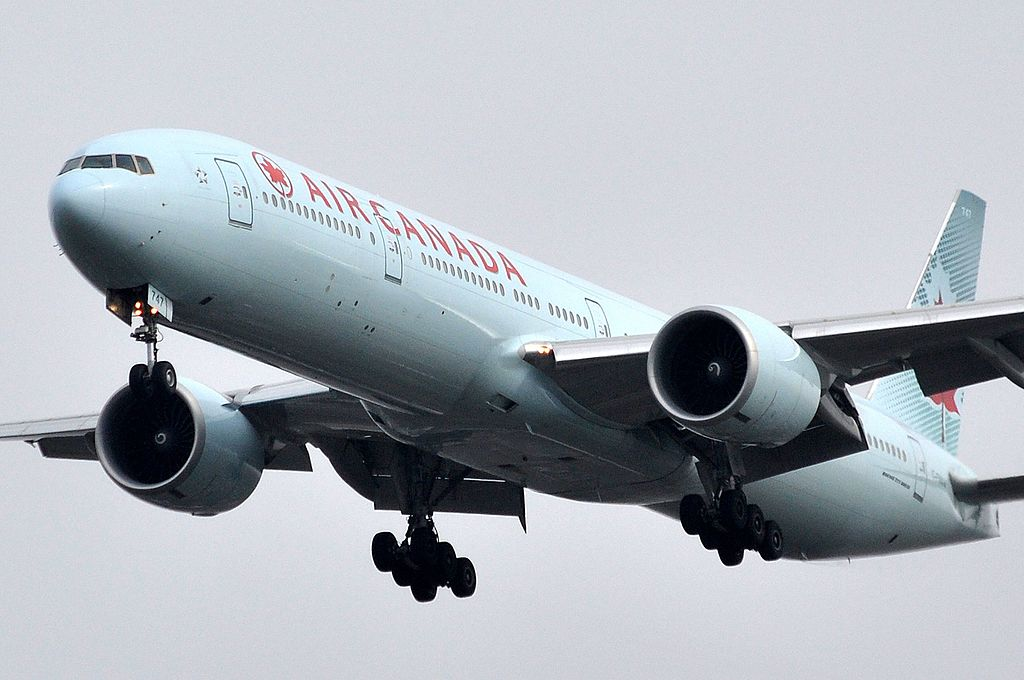 Boeing 777 300ER of Air Canada Fleet C FNNW on final approach at LHR