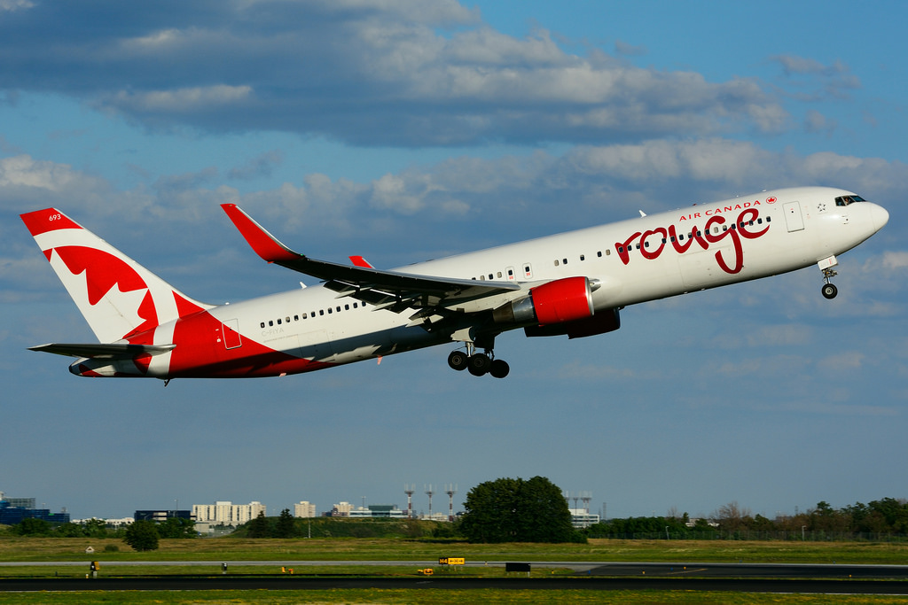 Boeing B767 33AERW Air CanadaRouge C FIYA leased from AWAS at Toronto Lester B. Pearson Airport YYZ