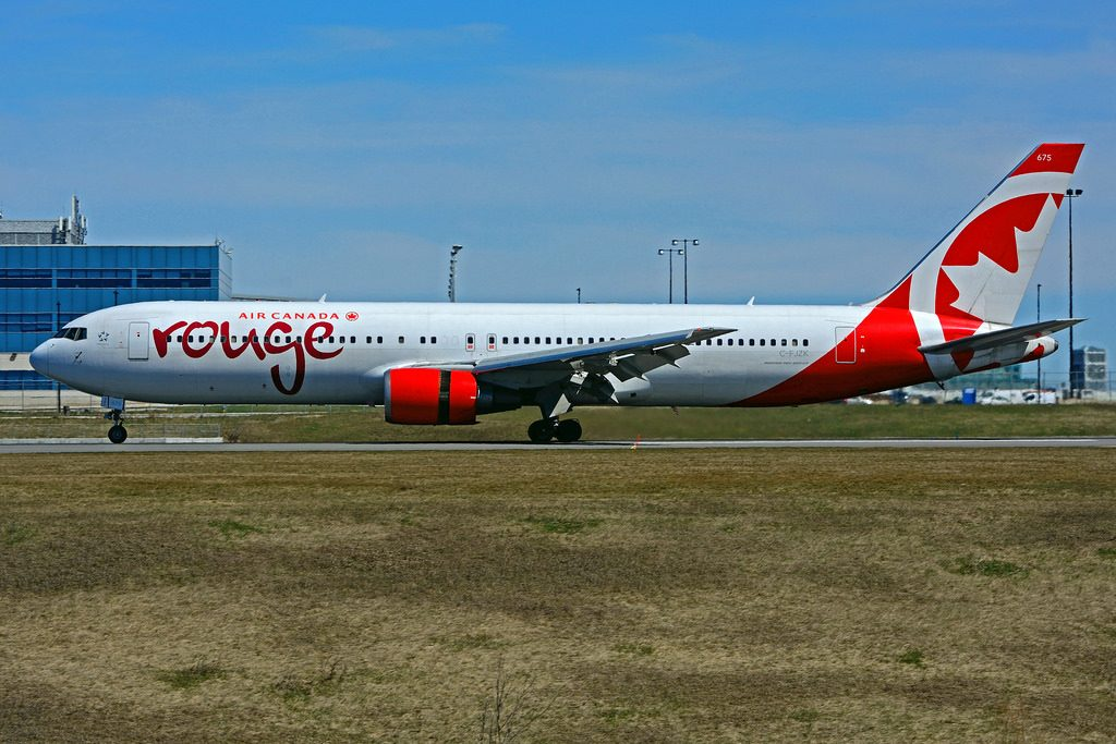 Boeing B767 3Q8ER rouge Air Canada C FJZK leased from AerCap at Toronto Lester B. Pearson Airport YYZ