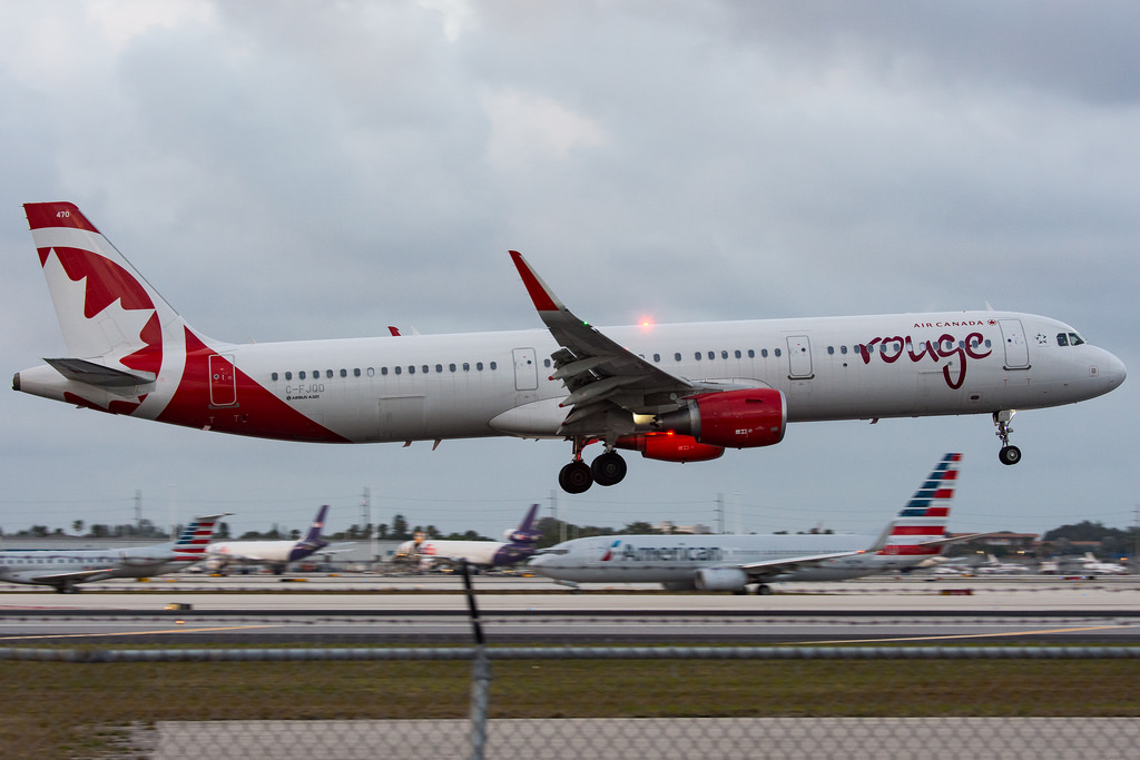 C FJQD Air Canada Rouge Airbus A321 200 landing at Miami International Airport