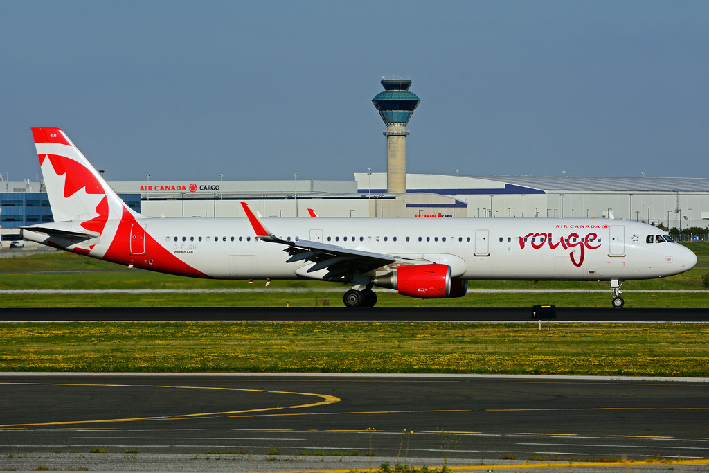 C FJQH Airbus A321 211SL rouge Air Canada leased from CIT Aerospace at Toronto Lester B. Pearson Airport YYZ