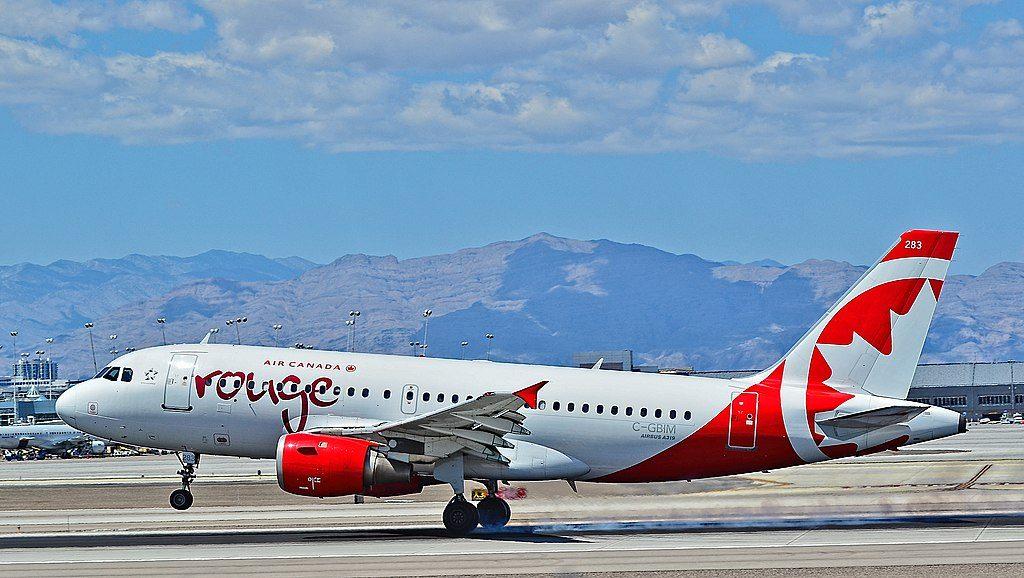 C GBIM Air Canada Rouge Airbus A319 114 cn 840 landing at Las Vegas McCarran International Airport LAS KLAS USA