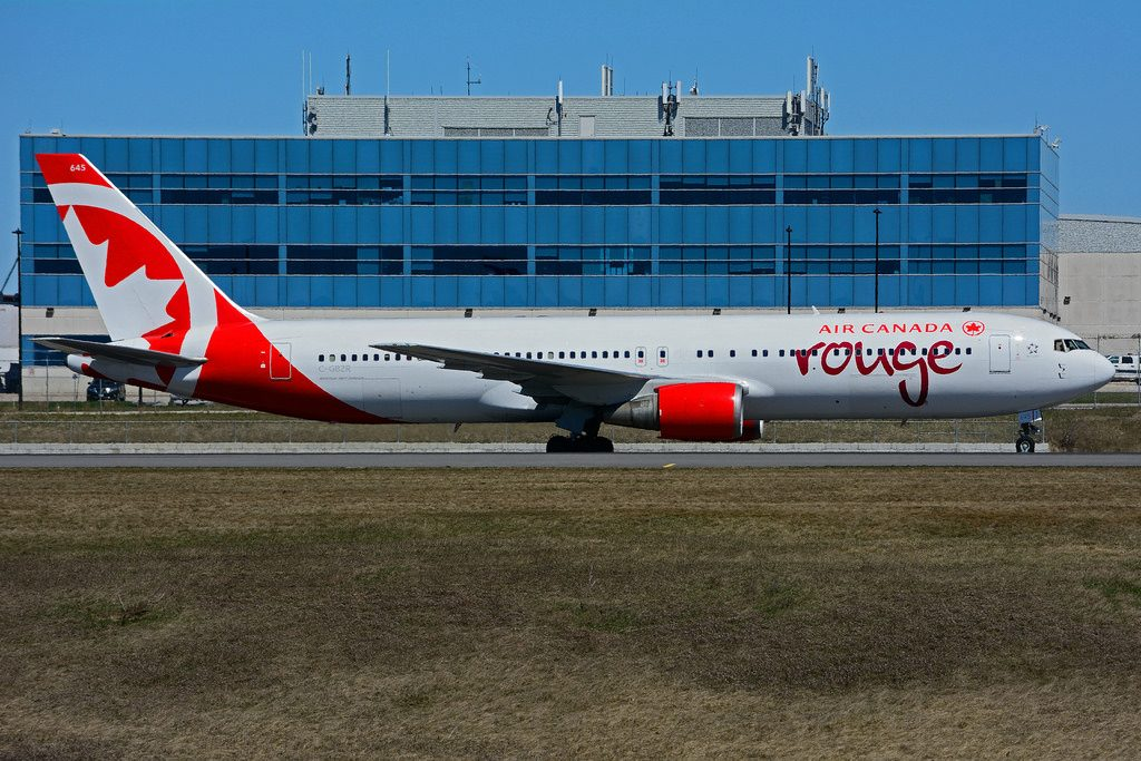 C GBZR Boeing B767 38EER rouge Air Canada leased from ILFC landing at Toronto Lester B. Pearson Airport YYZ