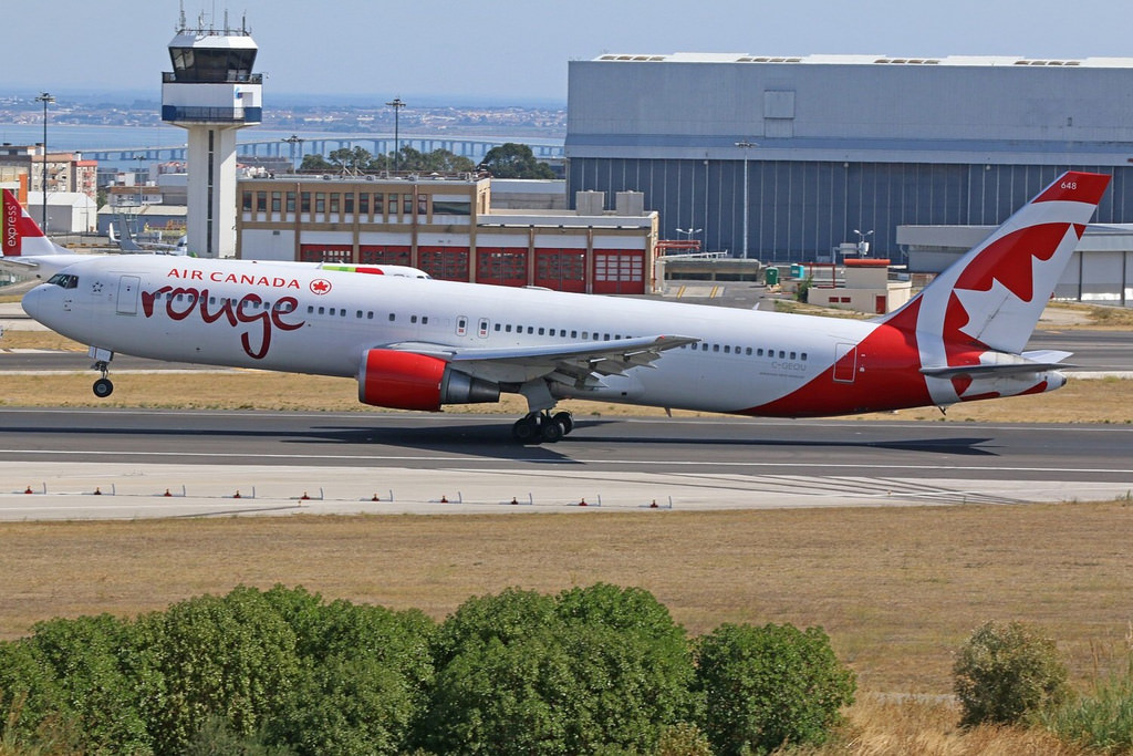 C GEOU Air Canada rouge Boeing 767 300ER departing Lisbon Humberto Delgado
