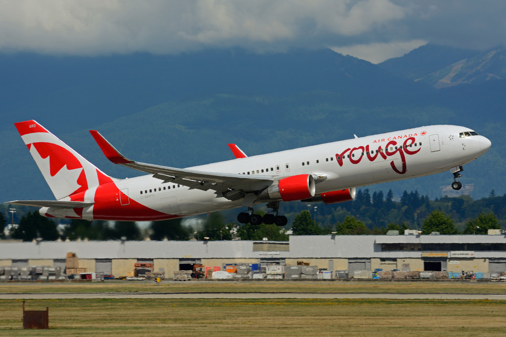C GHPN Boeing B767 33AERW rouge Air Canada leased from AWAS at Vancouver International Airport YVR