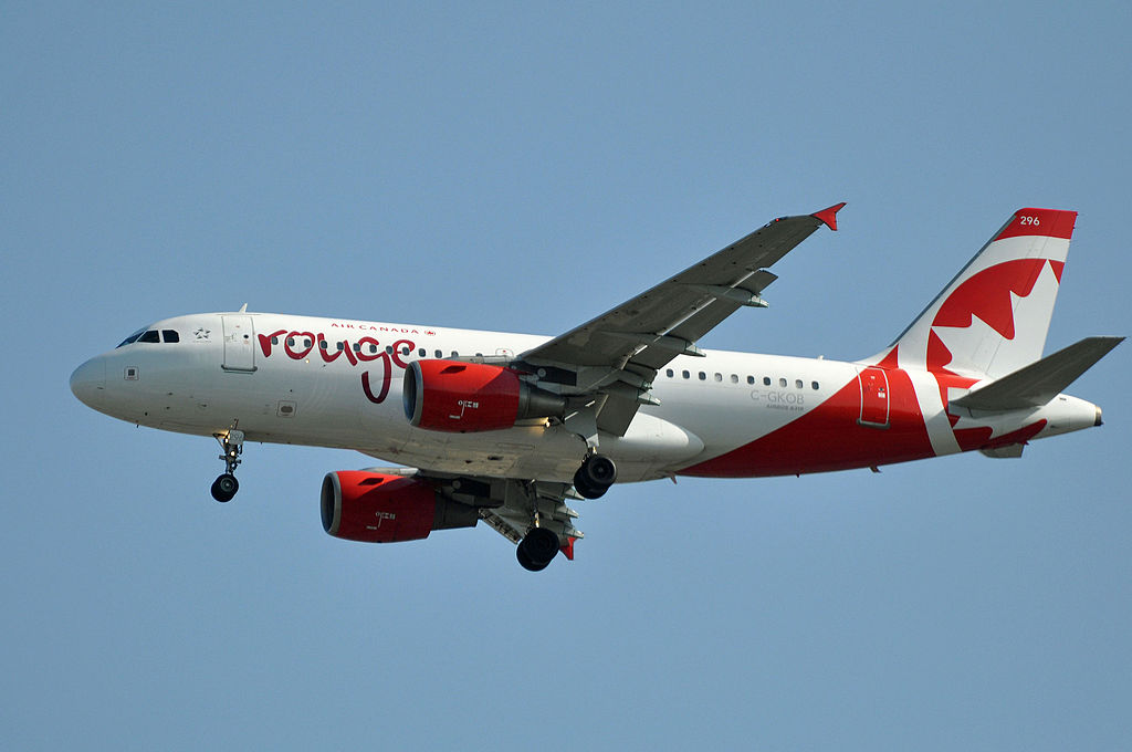 C GKOB Airbus A319 100 Air Canada Rouge aircraft fleet on final approach at Vancouver International Airport
