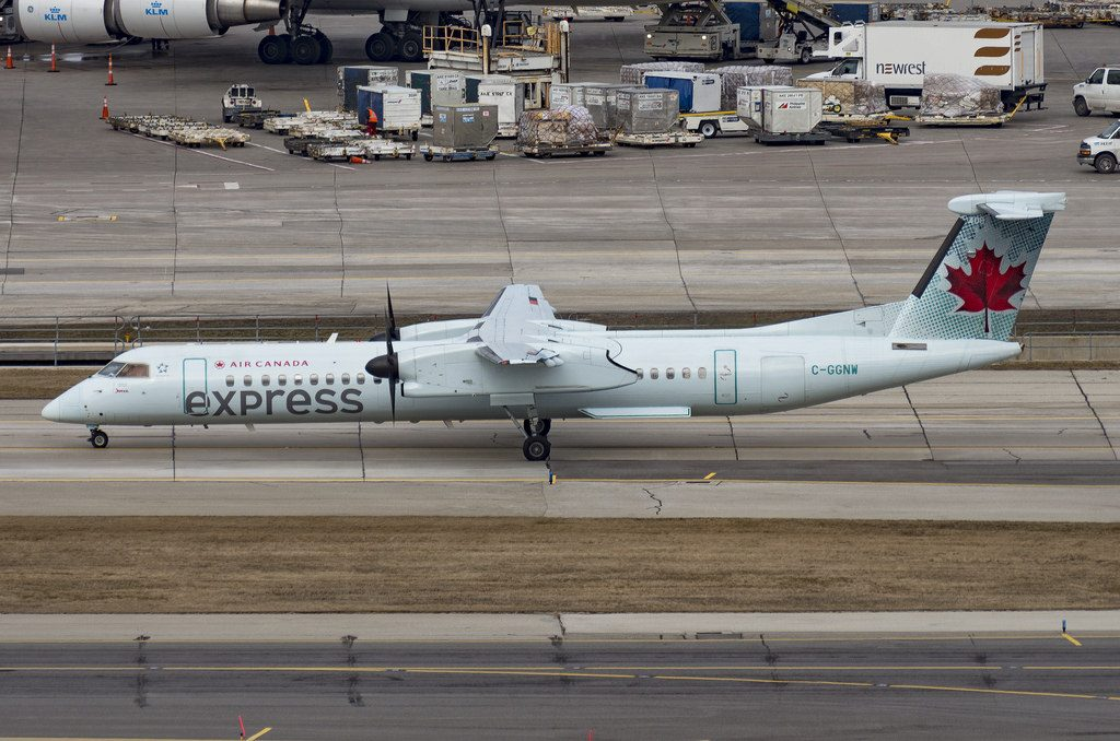 Air Canada Express C GGNW Bombardier DHC 8Q 402 4388 operated by Jazz Air axiing at a chilly Toronto