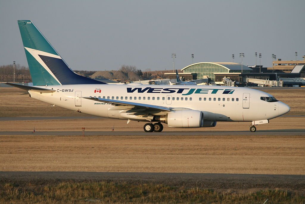 Boeing 737 600 of WestJet C GWSJ at Calgary International Airport